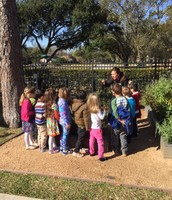 Mrs. Vaden asking the Navy Seals not to pull out plants from the garden.