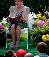 J.K. Rowling reading Harry Potter and the Sorceror's Stone to the children.