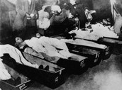 dead bodies in bins