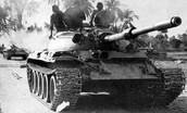 Pakistanis on a tank