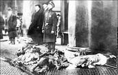 cops standing over dead bodies