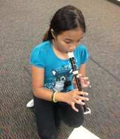Practicing on the recorder.