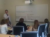Estabrook Staff work on the school's mission at Leadership Team