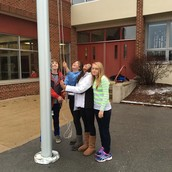 Students raising the flag on Thursday