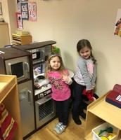 Sofia and Emma playing in the kitchen