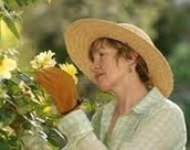 Her smelling flowers