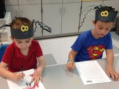 We had a good time learning about spiders and bats.  Don't they look cool wearing those precious spider hats.