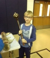 Nathan with a Native American weapon.