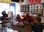 Mr. Davidson has lunch with several students.