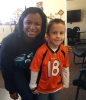 This little Bronco fan insisted on taking a picture with a Panther fan.