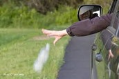 Person throwing something from moving vehicle
