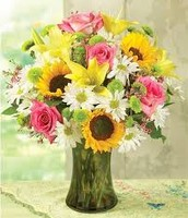 Daisys, sunflowers, roses, and lilies arrangment
