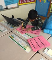 Josiah working hard on his assessment!