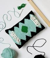 Small woven pillow.