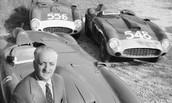 Enzo Ferrari posing with his car at the Ferrari factory in Manarello, Italy, 1956