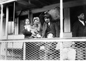 A family boarding onto the ferry to Ellis Island