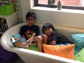 Buddy reading in the bathtub.