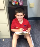 Emmitt is thinking hard for Writers Workshop.