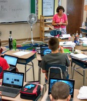 Mrs. Fonseca visits with Fifth Grade students