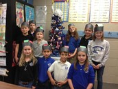 2nd graders with their Kwanzaa Kufi Hats