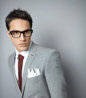 guy wearing grey suit and glasses