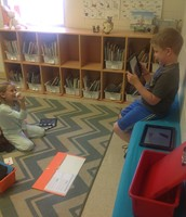 1st Graders in Mrs. Snowden's class are using their iPads to create a video of themselves retelling a story they just read. Students can use props in the video, too!