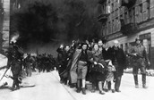 Jews being marched out of town.
