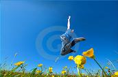 a boy jumping in a feild