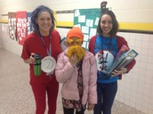 Ms. Cole and Ms. Wade, two of our cnu TEACHERS in Seuss form with The Lorax