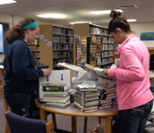 Students Help Inventory New Books