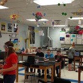 Atoms are orbiting about the room in Science