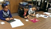 2nd Graders Taking Time to Create Small Pictures