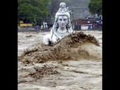 A submerged idol of Hindu Lord Shiva stands in the flooded River Ganges in Rishikesh. (PTI photo)