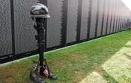 soldier boots, gun, and helmet