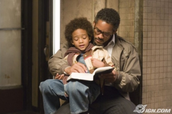 "Will Smith and his son playing the role of Gardner and his son in the film ""The Pursuit of Happiness"""