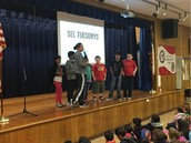 Coach & our Panthers lead us in an SEL lesson at assembly!