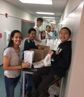 StuCo working on Christmas treats for Austin Street Shelter