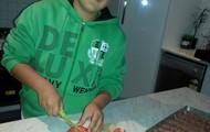 cutting the big tomato's
