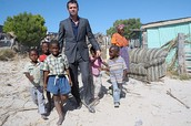 A man helping kids in Africa