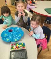 Tess, Hadley and Emma sorting color bears