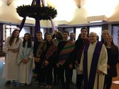 Eighth Grade presents Advent Prayer Service with Fr. Fred.