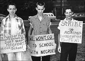 Whites protesting to keep blacks out of their schools.