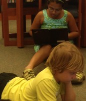 Juhi and Quin working hard on their poetry!
