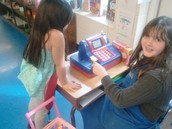 Isabella getting checked out by our 5th grade cashier.