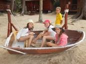 Three girls in a boat