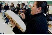Aboriginals in a local Toronto school playing instruments