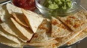 Baked Tortilla Chips with Salsa and Guac or Queso      $6.99