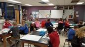 6th graders in art class