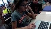 Maribel working on her Chromebook