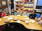 Second Graders taking their first bite of pumpkin pie!
